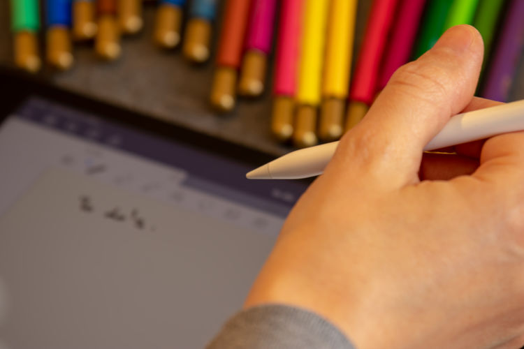 Close-up of person holding digitized pen