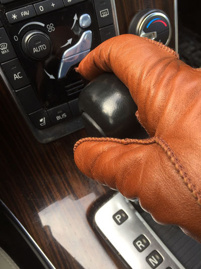 Adult Car Interior Changing Gear Classic Close-up Driving Human Body Part Human Hand Leather Glove Luxury One Person People Sporty Steering Wheel Style Tan Color Transportation Vehicle Interior