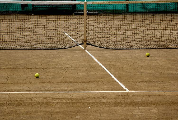 Tennis balls on ground in court