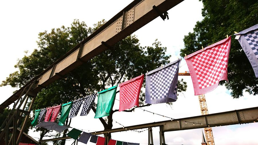 Low Angle View Hanging Multi Colored Sky Architecture Dishcloth Dishclothes Urban Different Perspective Different Flags No People Hanging Tree Trees Tree_collection  Urban Landscape Urbanphotography Urban Exploration TakeoverContrast