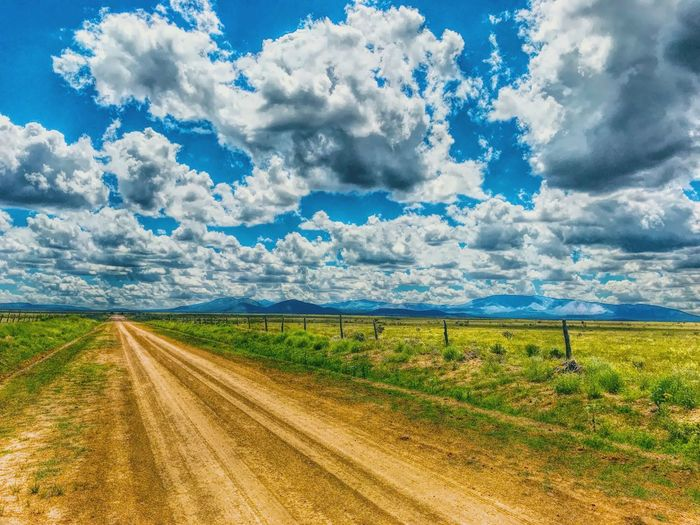 """""""Ever The Backroads"""" Venturing onto the backroads of rural Central New Mexico always yields a reward. New Mexico Photography New Mexico New Mexico Skies Dramatic Sky Clouds And Sky Clouds Rural Exploration Rural Scene Country Road Backroads Dirt Road Cloud - Sky Sky Landscape Beauty In Nature Road Rural Scene Scenics - Nature"""