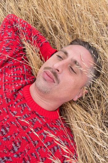 High angle view of a man sleeping