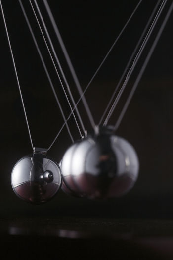 Close-up of lighting equipment hanging against black background