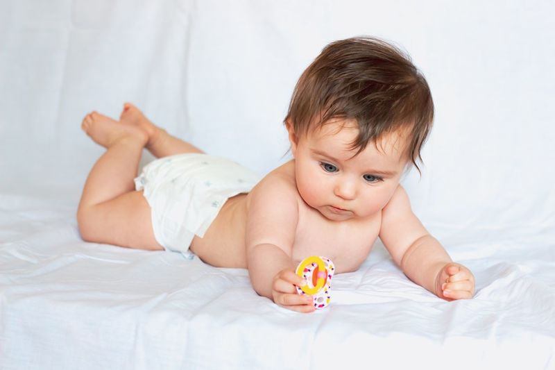 baby studying its pacifier White Background Shirtless Pacifier Focused Learning Diaper Toddler  Inspection Studying EyeEm Selects Childhood Child Bed Baby Young One Person Lying Down Indoors  Cute Babyhood Innocence Full Length Front View Relaxation