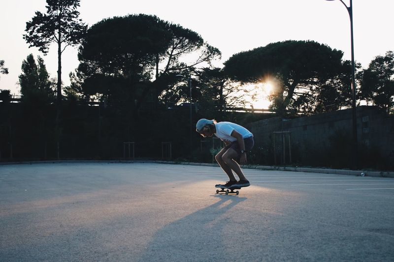 Full Length Of Man Skateboarding At Playground During Sunset