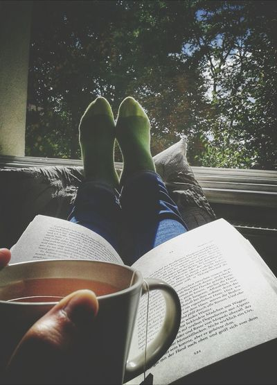 Enjoying the sunday afternoon Enjoying Life From My Window Time To Read Relaxing Book Cup Of Tea Calm Calmness Silence Eye4photography  Legs Pillow Tree Socks Green Green Color