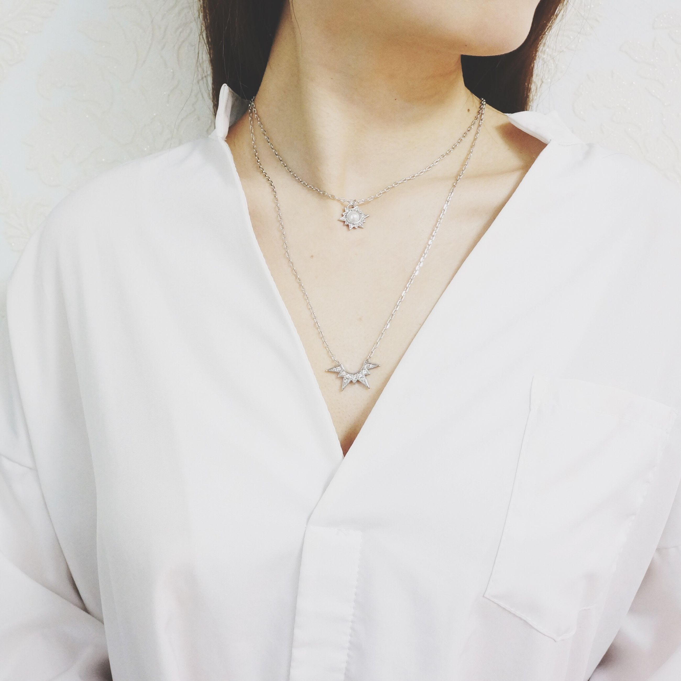 midsection, one person, necklace, real people, indoors, close-up, one woman only, day, people
