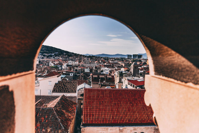 High angle view of town seen through arch
