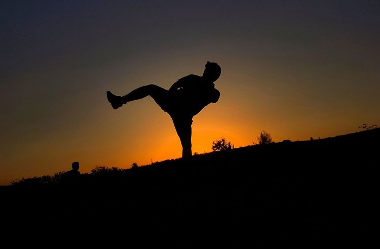 Silhouette Sunset Outdoors Nature Adult One Person Sky Only Men Perfect Angle... With My Mobile Cam ... Low Angle View Kickboxing Kick Sports Sports Photography
