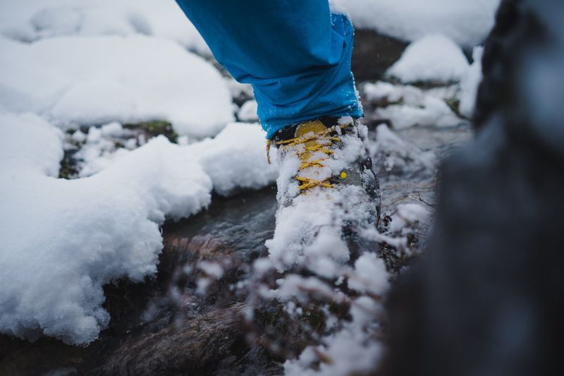 Hiking trough a river Live Authentic Hiking Conditions Water Approved Outdoor Water Resistant Water River Low Section Snow Cold Temperature Real People Winter One Person Lifestyles Outdoors Nature Human Leg Day Motion Human Body Part Adventure Close-up Beauty In Nature People Human Hand