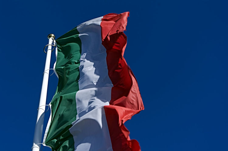 italian flag in wind Italia Italy Flag Blue Blue Sky Clear Sky Day Flag Flag In Wind Green, White, Red Italy Low Angle View No People Outdoors Patriotism Pride Sky Sunlight Sunny Day Wind Windy Day