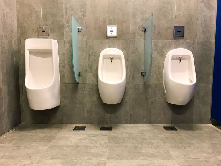 Urinals in public toilet. public restroom for men. White Floor Toilet Room Restroom Background Men Man Male Design Interior Urinal Bowl Public Relax Rest Mordern Public Building Public Restroom Bathroom Urinal Hygiene Indoors  In A Row Convenience Absence No People Toilet Bowl Flushing Toilet Day