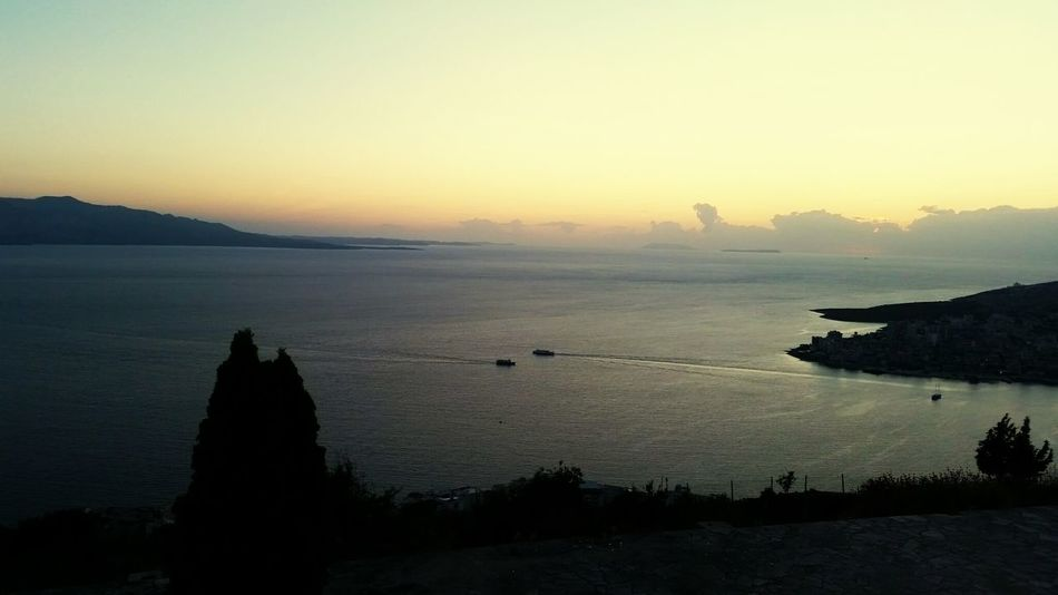 sunset landscape silhouette tranquility travel destinations scenics sea nature outdoors tranquil scene beauty in nature sky no people water beauty vacations Sarande Albania ALBANIA❤️ Mountain Cloud - Sky Water Landscape Travel Destinations Night Space horizon over water mountain tree winter The Graphic City