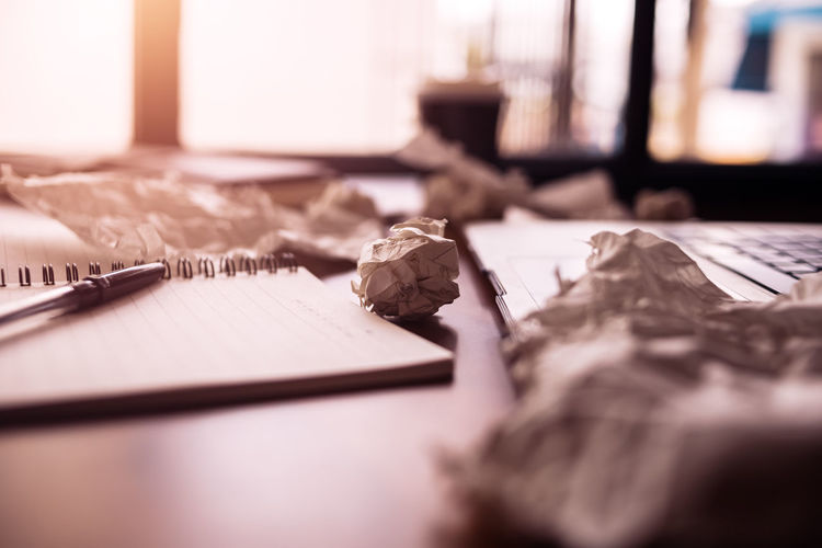 Close-up of crumpled papers on table