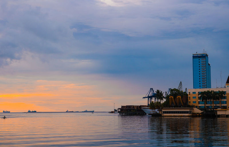 Before sunset at Losari Beach, Makassar Architecture Beauty In Nature Building Building Exterior Built Structure City Cloud - Sky Luxury Nature Nautical Vessel No People Office Building Exterior Outdoors Sea Sky Skyscraper Sunset Transportation Travel Travel Destinations Water Waterfront