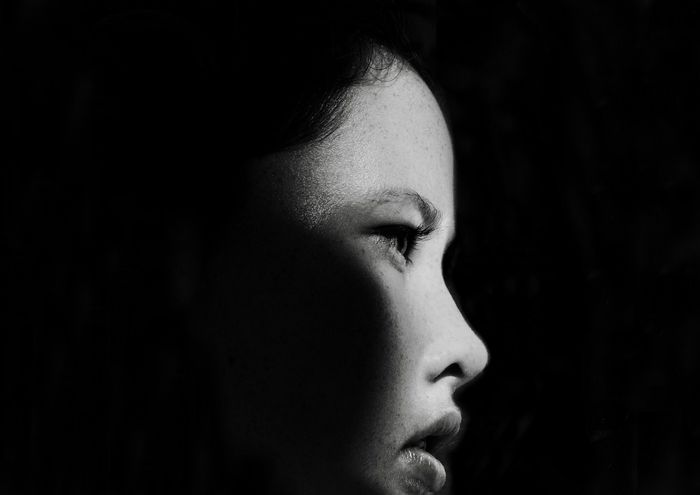 Portrait of a Teenager Shadow And Light EyeEm Selects Headshot Portrait Close-up Lifestyles Real People Human Body Part Black Background Beautiful Woman Body Part Women Young Women One Person Human Face A New Perspective On Life Capture Tomorrow