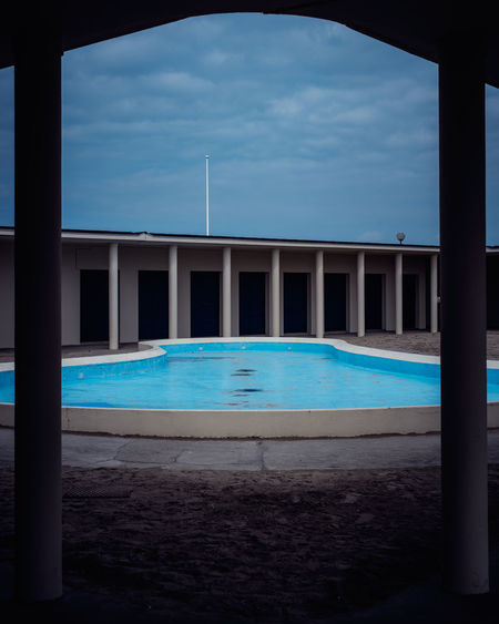 View of swimming pool against cloudy sky