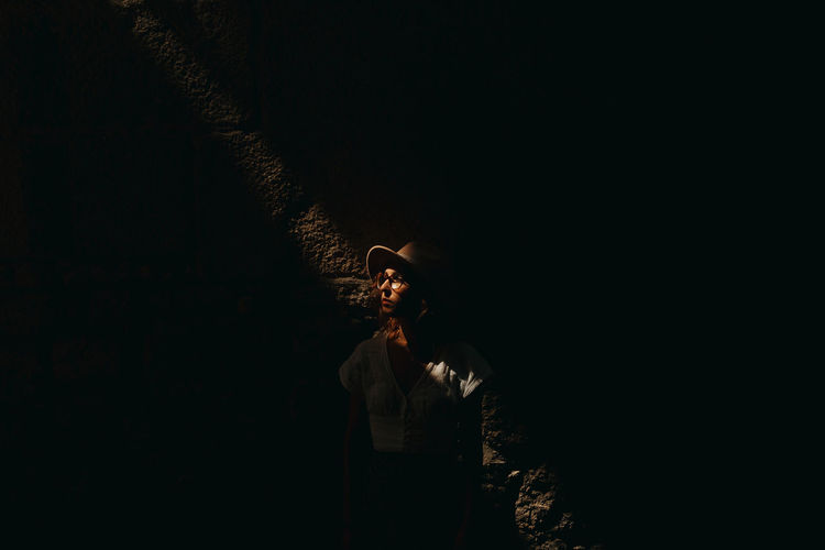 Man looking at illuminated fire crackers at night