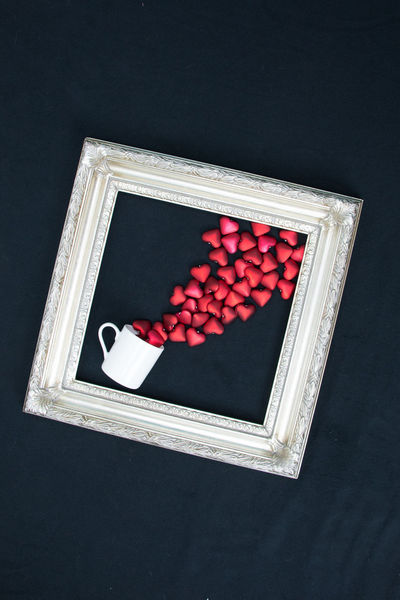 Sideways frame cup spilling hearts Love Valentine Valentine's Day  Angle Black Background Frame Hearts High Angle View No People Red Spilling Studio Shot