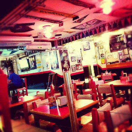 waiting for my nachos Restaurant Bar Sportbar Colorfull colour vignette photo pic tables chairs red black instagram dinner nachos beer tv