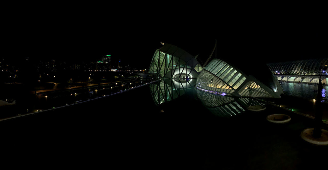 night, architecture, built structure, building exterior, illuminated, city, sky, no people, copy space, railing, building, nature, bridge, dark, transportation, connection, outdoors, travel destinations, bridge - man made structure, high angle view, modern, cityscape, office building exterior, luxury, skyscraper