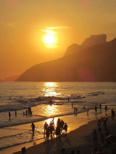 Beach Beauty In Nature Brasil Brazil Horizon Over Water Idyllic Ipanema Landscapes With WhiteWall Large Group Of People Mountain Nature Orange Color Scenics Sea Shore Silhouette Sky Sun Sunset Tranquil Scene Tranquility Vacations Water