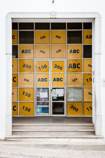 Text on yellow door of building