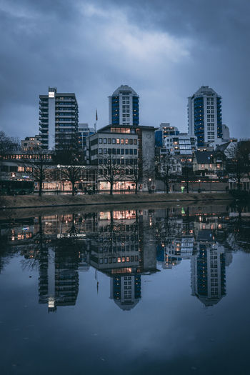 Architecture City Dark Skies Modern Reflection Skyscrapers Storm Day Dusk No Pepole Outdoors Reflections Reflections In The Water Sky Skyscraper Symmetrical Symmetry Urban
