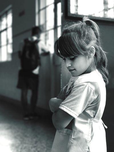 Schoolgirl standing in corridor