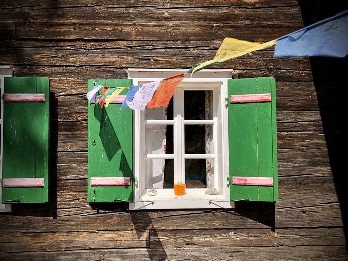 Green shutters on traditional austrian alpine house