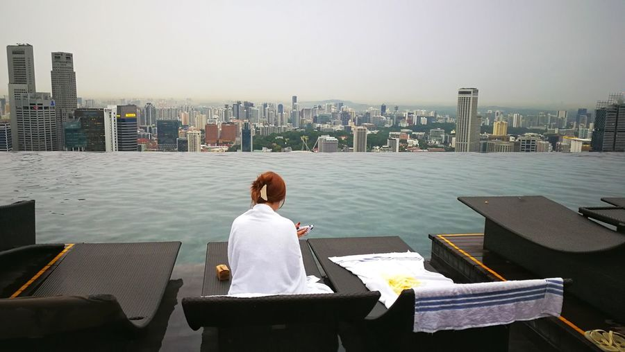 Alone Urban Skyline Infinity Pool Marina Bay Sands Hotel Singapore One Person One Woman Only Adult Cityscape Skyscrappers View From The Pool EyeEm Gallery EyeEm Selects Vacations Beautiful View From My Point Of View Relaxing Chilling Swimming Pool Outdoors Lifestyles Travel Destinations Real People Skyscraper An Eye For Travel