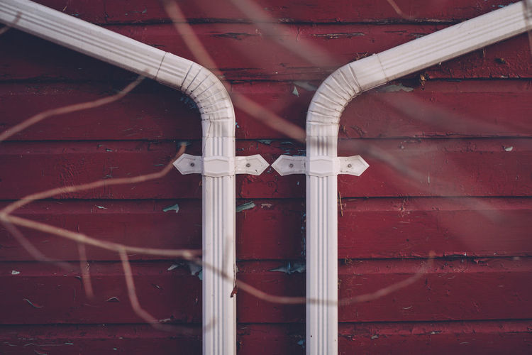 Pipes on red wall