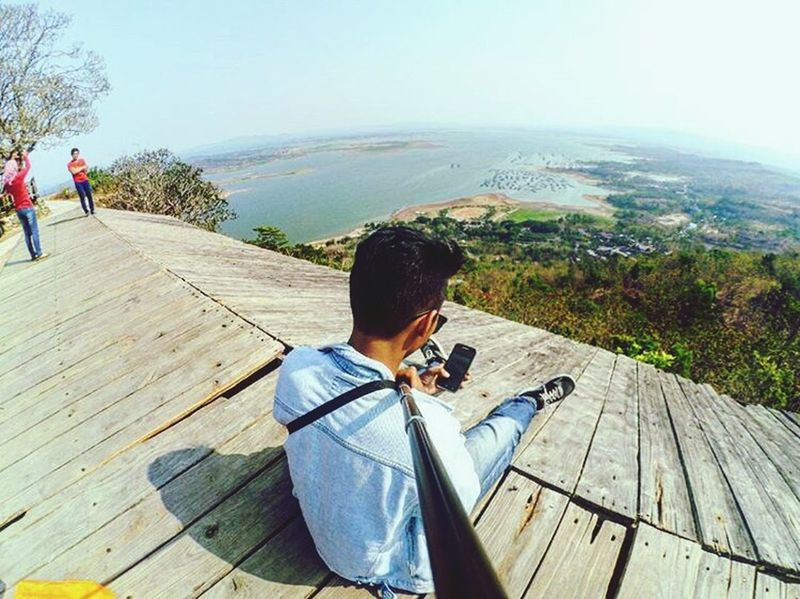 Tranquil Scene Railing Scenics Tranquility Beauty In Nature Vacations Full Length Fisheye Leisure Activity Fence In Front Of Landscape Men Rear View Panorama Tree Corals Kebumenmemotret Casual Clothing Bamboo - Plant Forest Standing Enjoyment Young Adult Explorejogja