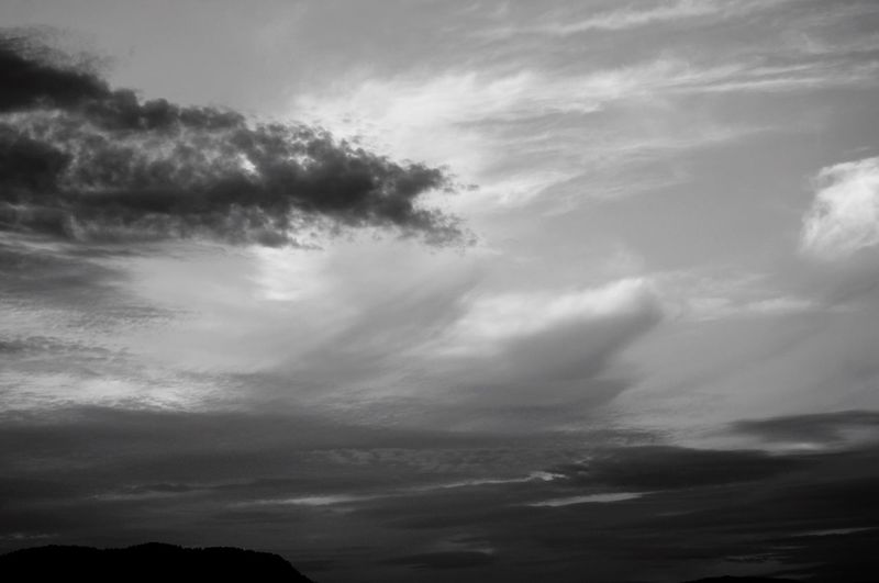 Cloud formations over the mountain in black and white. Nature_collection EyeEm Best Shots Scenics Focus On Foreground Selective Focus Low Angle View Blackandwhite Cloud - Sky Sky Beauty In Nature Tranquility Tranquil Scene Nature Low Angle View Dramatic Sky Cloudscape Environment Idyllic Backgrounds Day No People Outdoors Scenics - Nature Non-urban Scene Meteorology Silhouette
