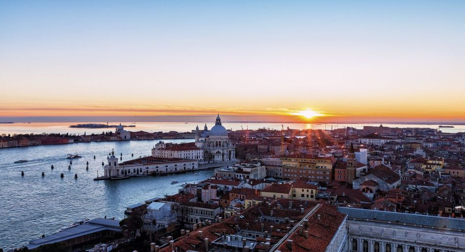 Sunset over Venice Venice, Italy Bell Tower Basilica Di Santa Maria Della Salute Piazza San Marco Venezia Seascape Scenery Italy Venezia Attractions Canals Waterways Veneto Region Adriatic Sea Lagoon Benatky Spectacular Turism Sunset Sky Architecture Built Structure Building Exterior Cityscape High Angle View Nature Building Travel Destinations Residential District