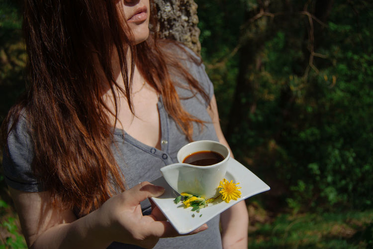 Midsection of woman holding tea
