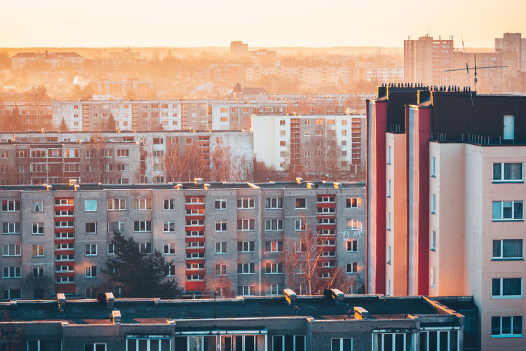 City mornings City City Mornings Apartment Architecture Building Building Exterior Built Structure City City Life Cityscape Day High Angle View No People Orange Color Outdoors Place Residential District Roof Sky Sunlight Sunrise Window