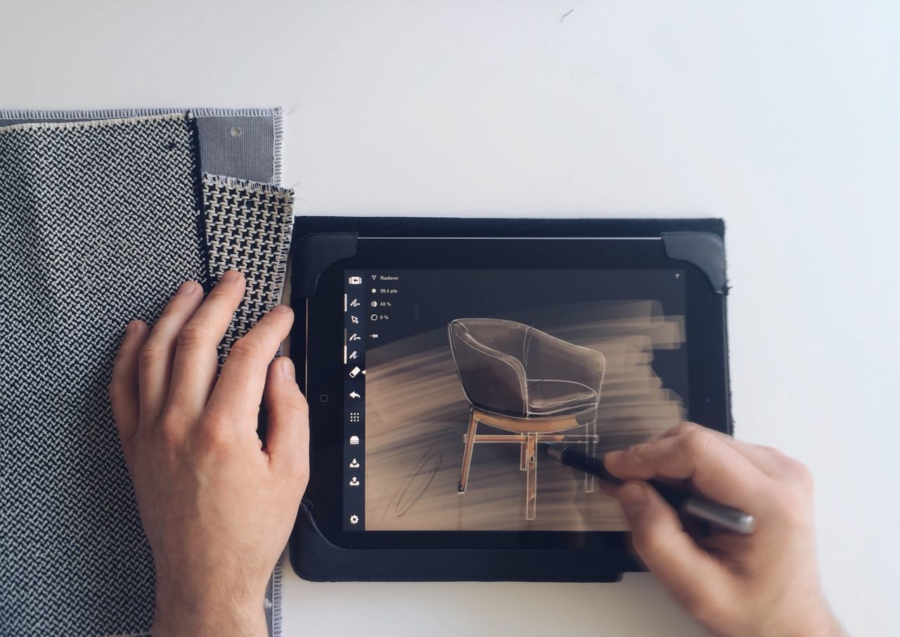 Cropped image of person working on digital tablet