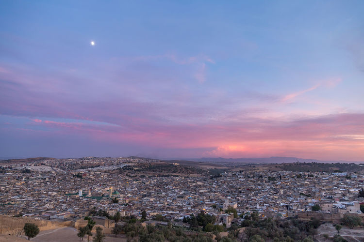 Aerial View Of Townscape Against Sky During Sunset