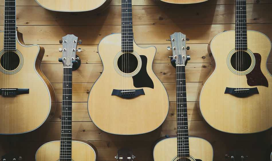 Classic guitar pattern exposed in store showroom Acoustic Guitar Background Chords Classic Guitar Body In A Row Many Music Musical Instrument Part Of Pattern Selective Focus Shop Showroom Sound Store String Stringed Instrument Wooden