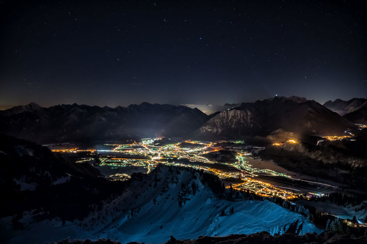 Lights of the villages from the mountains by night Night Mountain Sky Illuminated Scenics - Nature Mountain Range Beauty In Nature Star - Space Snow Nature Cold Temperature No People Architecture Winter Building Exterior Astronomy Space Tranquil Scene Environment Snowcapped Mountain Mountain Peak Long Exposure Winter Lights Alps Austria Tyrol