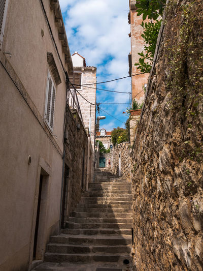 Architecture Cavtat  Cloud Croatia EyeEm Best Shots Low Angle View Stairs Steps Travel Travel Photography Traveling Wall Alley Building Exterior Built Structure Cloud - Sky Day House Hrvatska No People Outdoors Photography Sky The Way Forward Travel Destinations