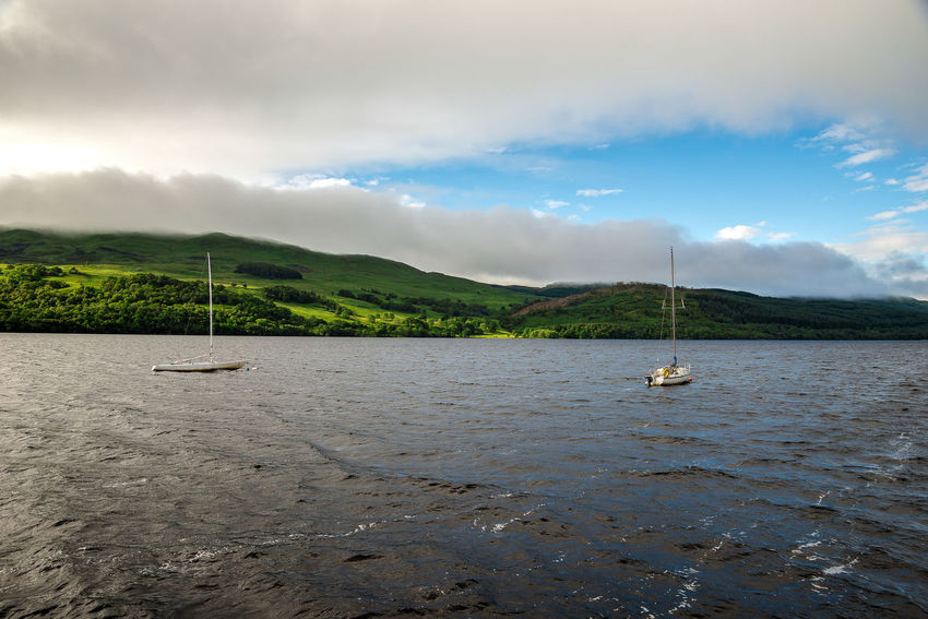 Two small boats anchored in Loch Tay waters, central Scotland Family Hills Holiday Loch Tay Perthshire Scotland Scottish Spectacular Travel Cloud - Sky Cruising Fishing Highlands Killin  Lake View Lakeshore Landscape Sailing Boat Scenics Spectacular Scenery Summer Tourism Tourist Destination Yacht