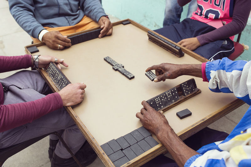 High angle view of people playing on table