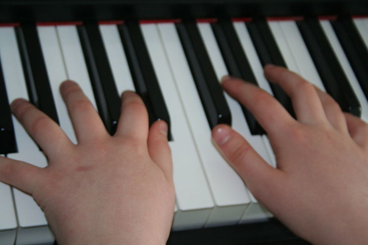 stroking the ivories! Close-up Communication Connection Cropped Focus On Foreground High Angle View Holding Human Finger Indoors  Leisure Activity Lifestyles Part Of Person Piano Keys Technology Unrecognizable Person Wireless Technology