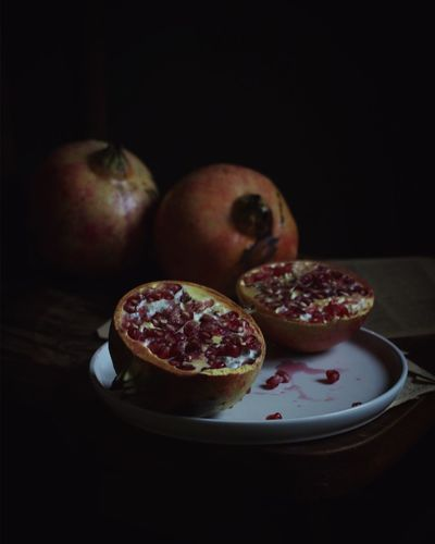 Fruit Healthy Eating Food Food And Drink Still Life Freshness Black Background No People Pomegranate Table Studio Shot Indoors  Cross Section Plate Close-up Pomegranate Seed Ready-to-eat Blood Orange Day EyeEmNewHere