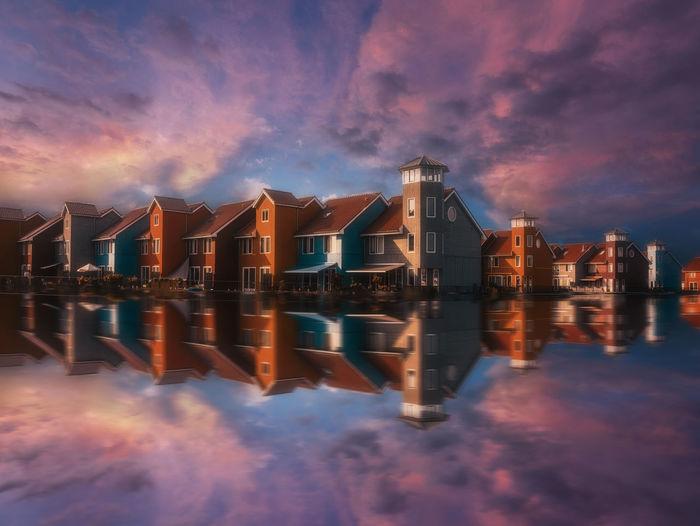Colourful scandinavian buildings at reitdiep city marina in groningen, the netherlands.