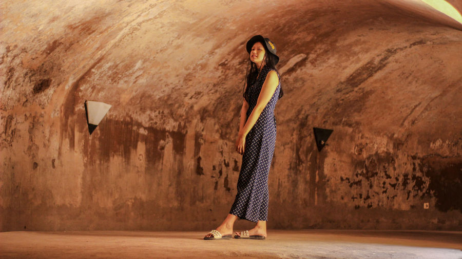 Beautiful woman standing in tunnel