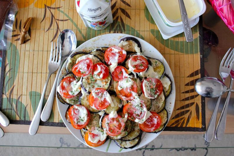 High Angle View Of Plate Filled With Tomatoes And Egg Plant