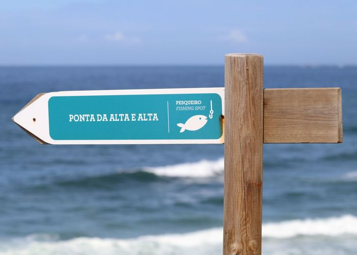Fishing Area Eye4photography  EyeEm EyeEm Best Shots EyeEmBestPics Waves, Ocean, Nature Seascape Seaside From My Point Of View Directional Sign Information Sign Beachphotography Close-up Minimalobsession Minimalism Minimal Beach Life Fishing Still Life EyeEm Gallery Taking Photos Portugal
